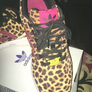 adidas Shoes - Adidas leopard print with red detail.